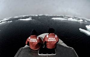 NOAA officers aboard one of the smaller survey vessels contemplate the vastness of the Chukchi Sea during the NOAA Ship Fairweathers reconnaissance survey in 2013. (Credit: NOAA)