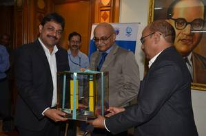 Neeraj Bansal, Chairman in-charge JNPT (left) receiving the Radiation Detection equipment from P. Sudhakar, CMD, ECIL (right) in the presence of Dr. R.K.Sinha Chairman, AEC and Secretary, DAE)