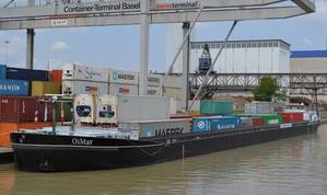 The OliMar at the Basel container port. (Photo courtesy of Cummins Marine)