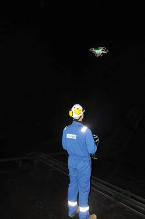 DNV GL surveyors tested a camera-equipped drone to visually evaluate structural components through video streamed to a tablet. One surveyor operated the drone, while a second checked the video feed in real time.