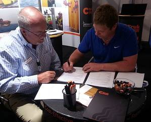 Paul Knight signing the agreement with CTruk chairman Andy White
