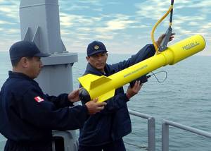 Peruvian Navy officers prepare to launch Fishers Proton 4 magnetometer. Photo: JW Fishers