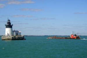 A tug pushes a dredging platform on Lake Erie near Pointe Mouillee, Mich. (Photo courtesy USACE)
