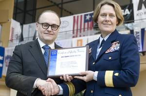 Nigel Cleave, CEO of Videotel, presenting a commemorative plaque to Rear Admiral Linda Fagan at CMA Shipping 2012.