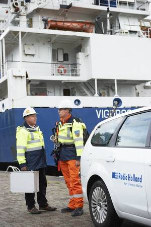 Two Radio Holland service engineers arriving at their job in the port of Rotterdam