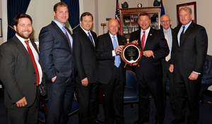 Rep. Bill Shuster is presented with the Champion of Maritime Award from the American Maritime Partnership.   L to R: Ben Billings, President, Offshore Marine Service Association; Stephen Martinko, Executive Director at Port of Pittsburgh Commission; Dave Grzebinski, President and CEO, Kirby Corporation; Thomas Allegretti, AMP Chairman and President and CEO American Waterways Operators; Rep. Bill Shuster; Barry Holliday, Executive Director for the Dredging Contractors of America; Matthew Paxton,