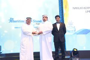 N-KOM Shipyard Director Mr Jassim Al-Shirawi (center) receiving the award from ADNATCO-NGSCO's CEO Dr. Ali Al Yabhouni (left) at the TMS Awards ceremony held in Dubai.  (Photo credit: The Maritime Standard)