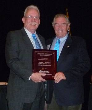 "Donald ""Boysie"" Bollinger accepts the 2011 Executive Leadership Safety Award."