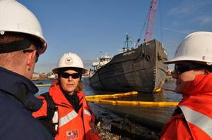 Stranded Tankship & Salvors: Photo credit USCG