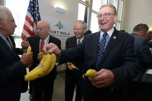Port of New Orleans President and CEO Gary LaGrange hands out Chiquita Bananas following the brands announcement to return its shipping operations to the Port of New Orleans . Pictured from left are Joe Accardo, Executive Director of the Ports Association of Louisiana, Port Commissioners Robert Barkerding, Jr. and Michael Kearney, and LaGrange.