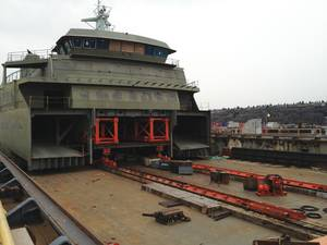 The process of installing the superstructure built by Nichols Brothers Boat Builders onto the hull of the M/V Tokitae at Vigor's yard, March 2013.