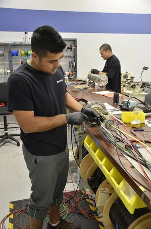 Trained MacArtney Inc. technicians servicing a Focal slip ring