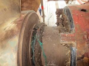 Typical netting and rope around rotating shaft damages aft seal.