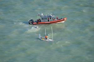 USCG Resuce two men from sinking vessel