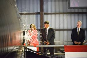USNS Brunswick (JHSV 6) Christening - Lee Booterbaugh breaking bottle