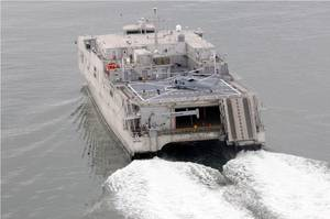 USNS Spearhead with helicopter during sea trials