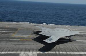 Unmanned X-47B on flight deck: Photo credit USN