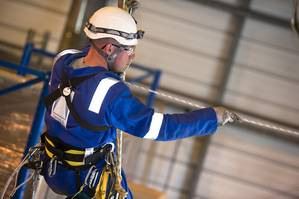 A Dron & Dickson rope access technician working at height.