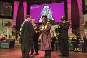 (From left) The Apprentice School Director Everett Jordan presented the school's 10,000th graduate, Sara Ruggles, with a plaque to commemorate the milestone as Newport News Shipbuilding President Matt Mulherin and Newport News Shipbuilding Vice President of Trade Operations Ray Bagley joined other shipyard leadership in applause. Photo by John Whalen/HII