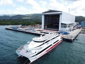 Hull 680 in front of the new 120 metre assembly bay at Austal Philippines shipyard in Balamban, Cebu (Image: Austal)