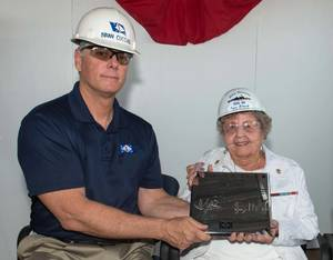 Ingalls Shipbuilding President Brian Cuccias presents a ceremonial keel plate to Ima Black, the sponsor of her husband's namesake ship, Delbert D. Black (DDG 119). (Photo by Andrew Young/HII)