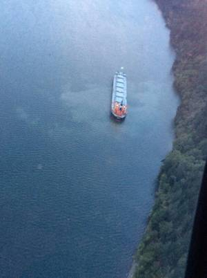 Coast Guard monitors aground motor vessel in Columbia River  (Photo by Petty Officer 1st Class Levi Read)