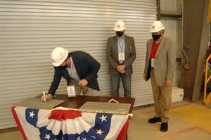 GLDD's Bill Hanson, SVP; Chris Roberts, VP, TSHD Fleet Manager and Vidar Lindmoen, Program Director initial the keel. (Photo: Conrad Shipyard)