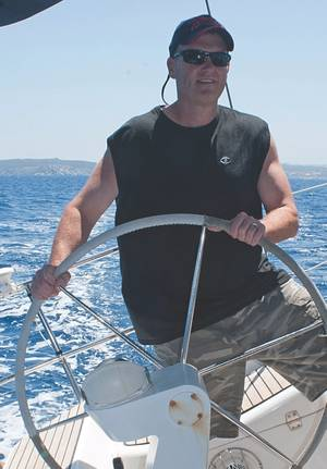 """Throwback Thursday"" from the Maritime Reporter archives: Greg at the wheel on a sailing excursion off the coasts of Italy and France in August 2011"