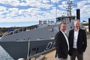 Patrick Gregg (Left) and David Singleton standing in front of a Guardian-class patrol Boat at Austal's Australian shipyard in Henderson, Western Australia. (Photo: Austal)