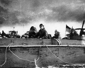 Troops and crewmen aboard a Coast Guard manned LCVP as it approaches a Normandy beach on D-Day, June 6, 1944. (Photograph from the U.S. Coast Guard Collection in the U.S. National Archives.)
