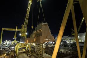 Two cranes were used to lift the 320-ton aft deckhouse onto guided missile destroyer Jack H. Lucas (DDG 125) at Ingalls Shipbuilding in Pascagoula, Miss. (Photo: HII)