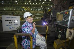 Ima Black reacts after starting a plasma cutter machine at Ingalls Shipbuilding, officially beginning construction of the Arleigh Burke-class destroyer Delbert D. Black (DDG 119), which is named in honor of her late husband. (Photo by Andrew Young/HII)