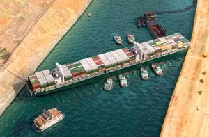 Illustration of the Ever Given blocking the Suez Canal - Credit: Corona Borealis/AdobeStock