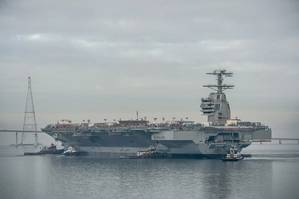 The aircraft carrier Gerald R. Ford (CVN 78) was moved Sunday to Newport News Shipbuildings Pier 3, where it will undergo additional outfitting and testing for the next 28 months. Photo by Chris Oxley