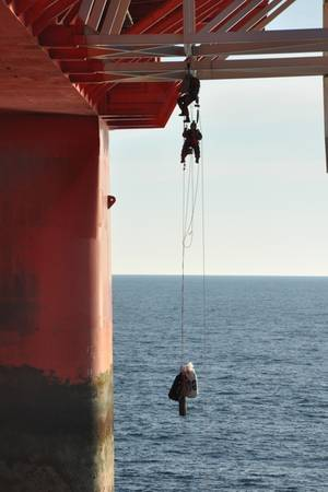 Greenpeace activists boarding the drilling rig Transocean Spitsbergen.Photo credit: Transocean.