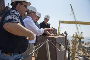 Rep. Bradley Byrne (second from left) toured Ingalls Shipbuilding and the amphibious transport dock John P. Murtha (LPD 26). Pictured with Byrne are (left to right) LPD 26 Ship Construction Manager Hank Corcoran, LPD Program Director Mike Duthu and Ingalls Shipbuilding President Brian Cuccias. Rep. Steven Palazzo also participated in the tour but is not pictured. Photo by Andrew Young/HII