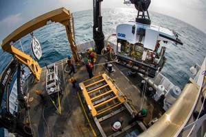 Okeanos Explorers dual-body ROV system is loaded from the aftdeck of the ship into the water before conducting an exploration dive. (Credit: NOAA)