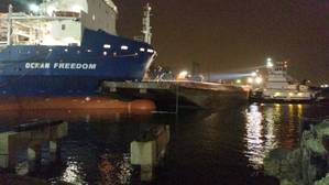 The Ocean Freedom, a 480-foot cargo ship, is connected to a moored Kirby Inland Marine barge after a collision in the Corpus Christi Inner Harbor Thursday. (U.S. Coast Guard photo by Gordon Bellinger)