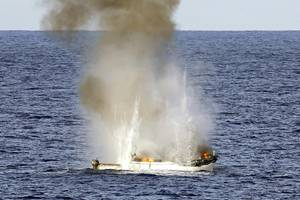 Pirate skiff destroyed: Photo credit ABIS Jayson Tufrey, Commonwealth of Australia