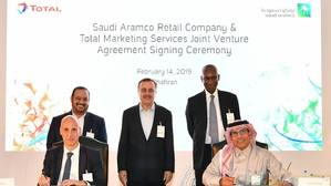 Group photo of Saudi Aramco management and Total management