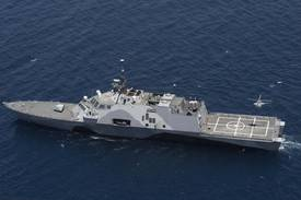 MQ-8B Fire Scout unmanned helicopter prepares to land on the littoral combat ship USS Freedom (LCS 1) off the coast of Southern California.  (U.S. Navy Photo)