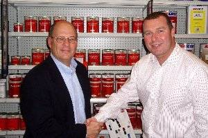 Steve Schultz (left) gets a farewell handshake from Neil Plowman (right), Interlux Global