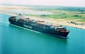 A containership transits the Suez Canal (Photo courtesy of the Suez Canal Authority)