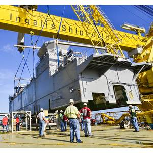 Ingalls Shipbuilding lands the 700-ton deckhouse on the amphibious assault ship Tripoli (LHA 7) on July 9. (Photo by Lance Davis/HII)
