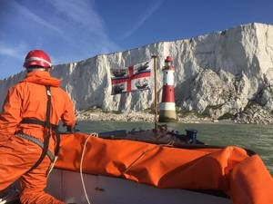 The UK Department of Transport is to order new vessel for Trinity House to replace the THV Patricia and provide safety information and guidance for ships in UK waters and abroad.  A Trinity House workboat approaching Beachy Head Lighthouse on the south coast of England. Trinity House's fleet of support vessels carries out a number of activities around England, Wales and the Channel Islands in support of its role as a General Lighthouse Authority.  (Photo: Trinity House)
