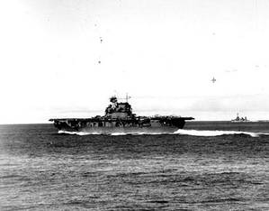 USS Enterprise (CV-6) steaming at high speed at about 0725 hrs, June4,  1942, seen from USS Pensacola (CA-24). The carrier has launched Scouting Squadron Six (VS-6) and Bombing Squadron Six (VB-6) and is striking unlaunched SBD aircraft below in preparation for respotting the flight deck with torpedo planes and escorting fighters. (Official U.S. Navy Photograph, U.S. National Archives.)