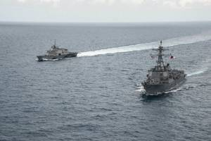 Littoral combat ship USS Fort Worth, guided missile destroyer USS Sampson and MH-60R Seahawk from Helicopter Maritime Strike Squadron (HSM) 35 operate together in the Java Sea while supporting the Indonesian-led search effort for AirAsia flight QZ8501. (U.S. Navy photo Brett Cote)