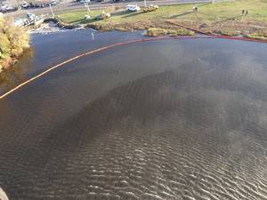 Aerial view of the oil spill near the Ronald Reagan Washington National Airport, Oct. 30, 2015. A safety zone was established with a 1,500-yard radius from source of the spill. (U.S. Coast Guard photo by Nicholas Rodriguez)