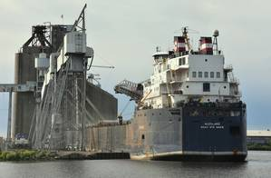 The Canada-flag Algolake loading wheat at the CHS elevator in the Port of Duluth-Superior. (Photo: Terry White / Chamber of Marine Commerce)