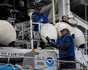 NOAA ships spent the last several days preparing for their Arctic missions. Here, Chief Bosun Jim Kruger (front) works with Jason Kinyon and Lindsey Houska on NOAA Ship Rainier as they get ready to depart this week for the summers first Arctic survey project, in Kotzebue Sound.(Credit: NOAA)